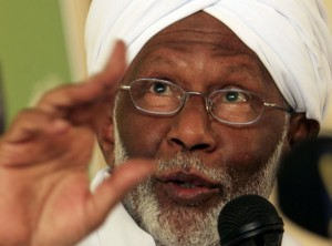 Islamist opposition leader Hassan al-Turabi of the Popular Congress Party (PCP) speaks during a news conference after his visit to Egypt, at the party's headquarters in Khartoum July 30, 2011. REUTERS/Mohamed Nureldin Abdallah (SUDAN - Tags: POLITICS HEADSHOT RELIGION)