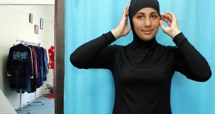 """Sydney, AUSTRALIA:  Australian model Mecca Laalaa wears an Islamic swimsuit by Muslim fashion designer Aheda Zanetti at the Islamic Sport & Swimwear shop in Sydney, 12 January 2007. The new """"Burqini"""" is marketed as the first two-piece Muslim swimwear for women and is attracting customers from North America, Europe and across the Middle East.  AFP PHOTO/Anoek DE GROOT  (Photo credit should read ANOEK DE GROOT/AFP/Getty Images)"""